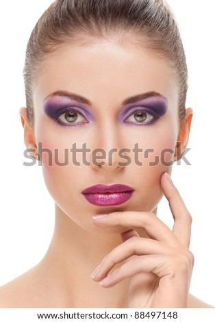 Attractive young beautiful woman looking to the camera on white background