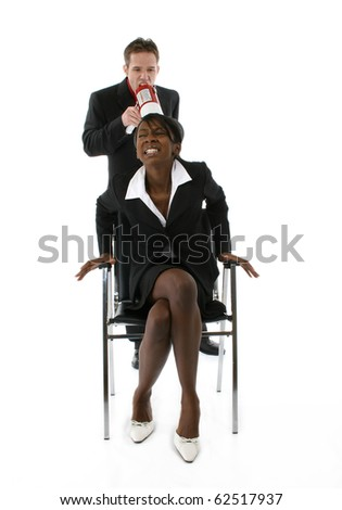 Attractive young black and white business team over white background, Man yelling at woman through megaphone.