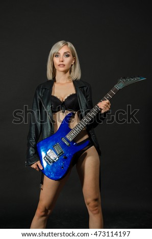 Royalty-free Woman playing music on a bass guitar ...