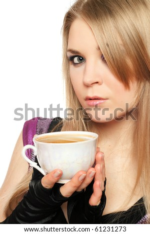 Attractive young blonde with a cup of tea. Isolated