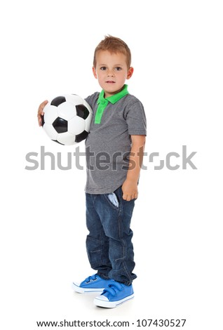 Attractive young boy holding soccer ball. All on white background.
