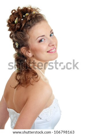 Attractive young bride with beautiful wedding hairstyle - isolated on white