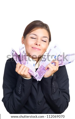 Attractive young brunette businesswoman happy to receive a large sum of money. Isolated against white background.