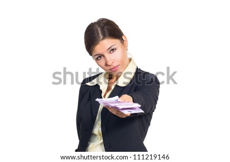 Attractive young brunette businesswoman offers, gives money. Isolated against white background.