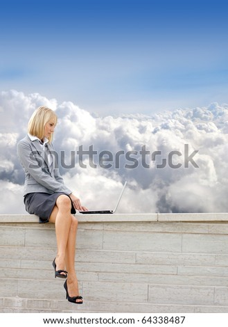 Attractive young business woman over sky  background