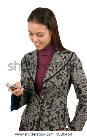 Attractive young business woman sending a text message.