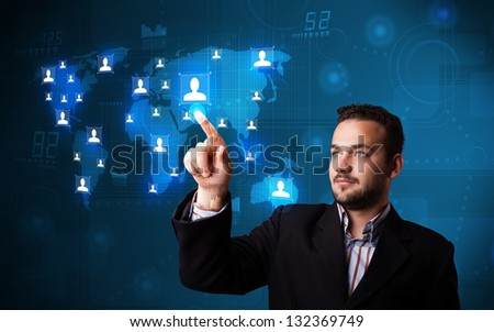 Attractive young businessman choosing from social network map