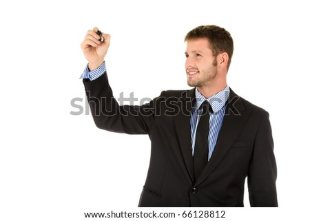 Attractive young businessman with black marker in hand, writing. Studio shot. White background.