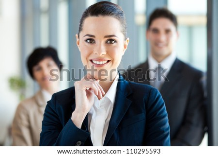 attractive young businesswoman and colleagues