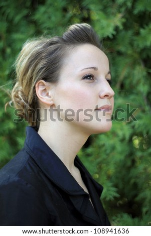 Attractive Young Businesswoman Looking to Side