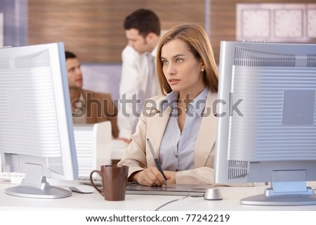 Attractive young businesswoman participating at computer training course, using tablet.?