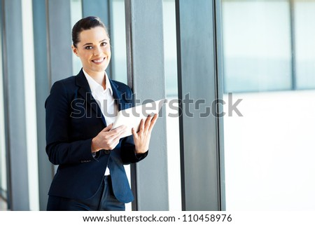attractive young businesswoman using tablet computer
