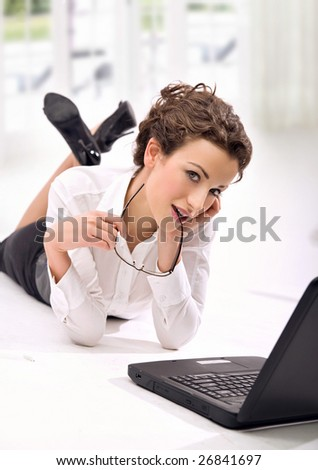 Attractive young businesswoman with notebook