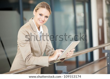 attractive young businesswoman with tablet computer