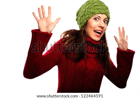 Attractive young caucasian woman in red sweater on white background