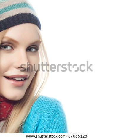 attractive young caucasian woman in warm colorful clothing  with yellow leaf studio shot isolated on white
