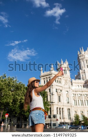 attractive young cheerful woman taking a selfie in Madrid, Spain #1149769325