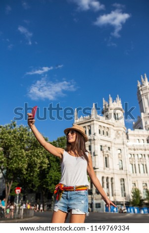 attractive young cheerful woman taking a selfie in Madrid, Spain #1149769334
