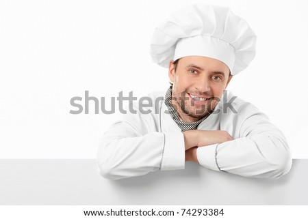 Attractive young chef on a white background