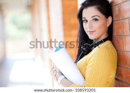 attractive young college girl reading book