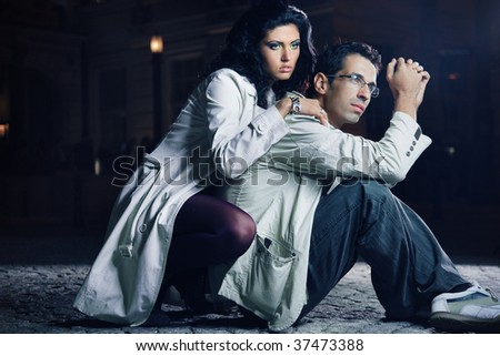Attractive young couple at night