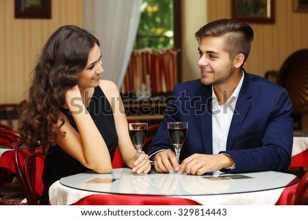 attractive young couple dating at the restaurant #329814443