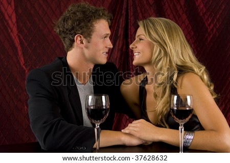 Attractive young couple drinking wine
