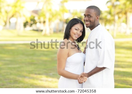 Attractive young couple in a nature setting