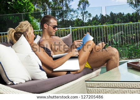 Attractive young couple in backyard patio