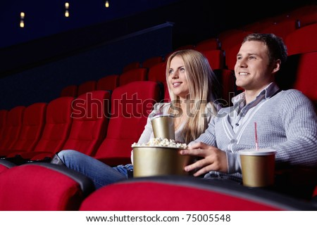 Attractive young couple looking at a movie theater