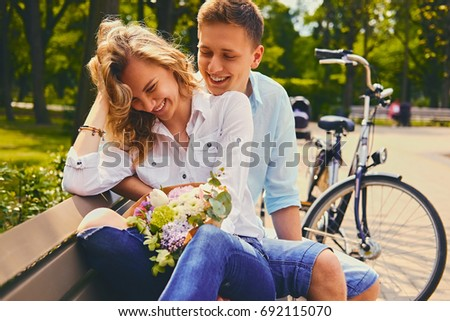 Attractive young couple on a dating in a summer park. #692115070