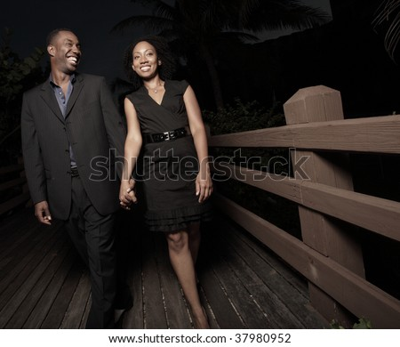 Attractive young couple walking at night