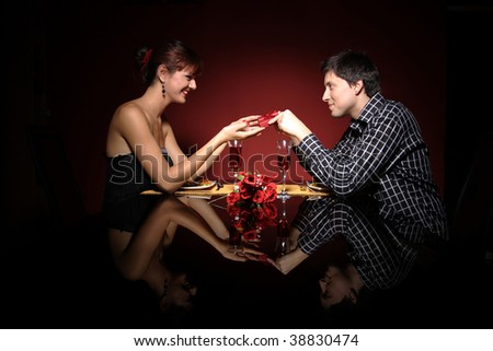 Attractive young couple with a gift in hands