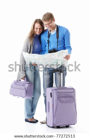 Attractive young couple with suitcases and map isolated - stock photo