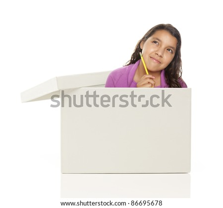 Attractive Young Ethnic Female with Pencil Popping Out and Thinking Outside The Box Isolated on a White Background.