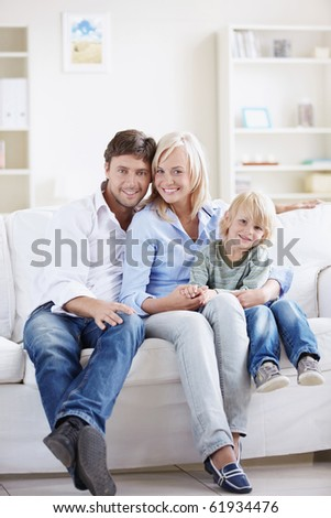 Attractive young family with a child at home