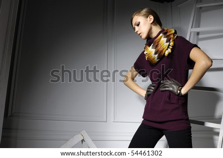 Attractive young fashion model in designer dress posing - stock photo