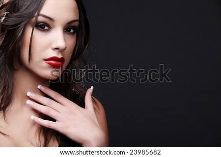 Attractive young fashion model posing in black dress.