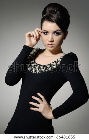 Attractive young fashion model posing in the studio