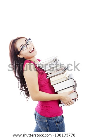 Attractive young female college student carrying a stack of books. shot in studio