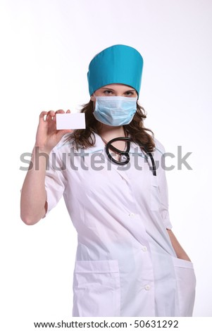 Attractive young female doctor holds a blank card, isolated on white background
