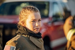 Attractive young female emergency responder firefighter.