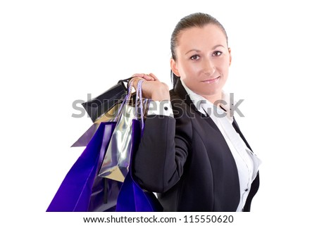 Attractive young female holding shopping bags against white background