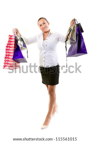 Attractive young female holding shopping bags isolated on white