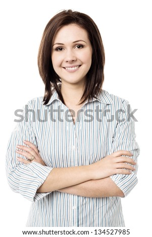 Attractive young female with a radiant smile arms crossed