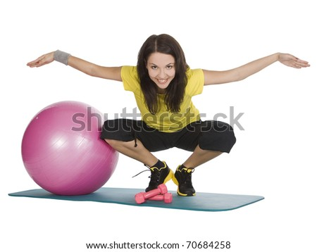 Attractive young female with fitness dumbbells in sport center - stock photo