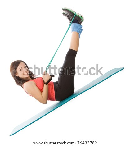 Attractive young female with fitness expander in stretching