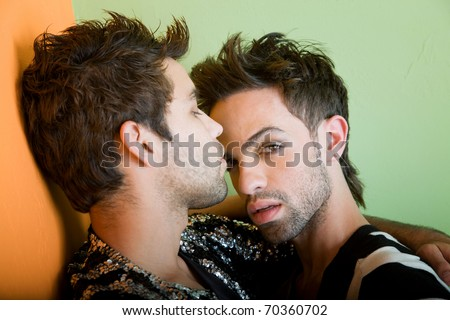 stock photo : Attractive young gay couple with stylish hair and clothing