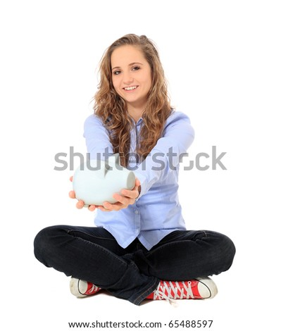 Attractive young girl holding piggy bank. All on white background.