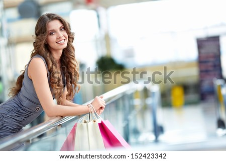 Attractive young girl in a store